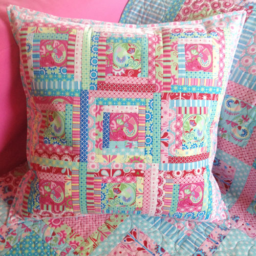 Chirpy Lola log cabin cushion
